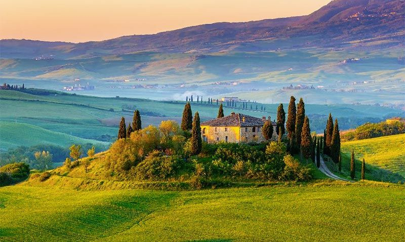bigstock-Tuscany-landscape-at-sunrise-663537491